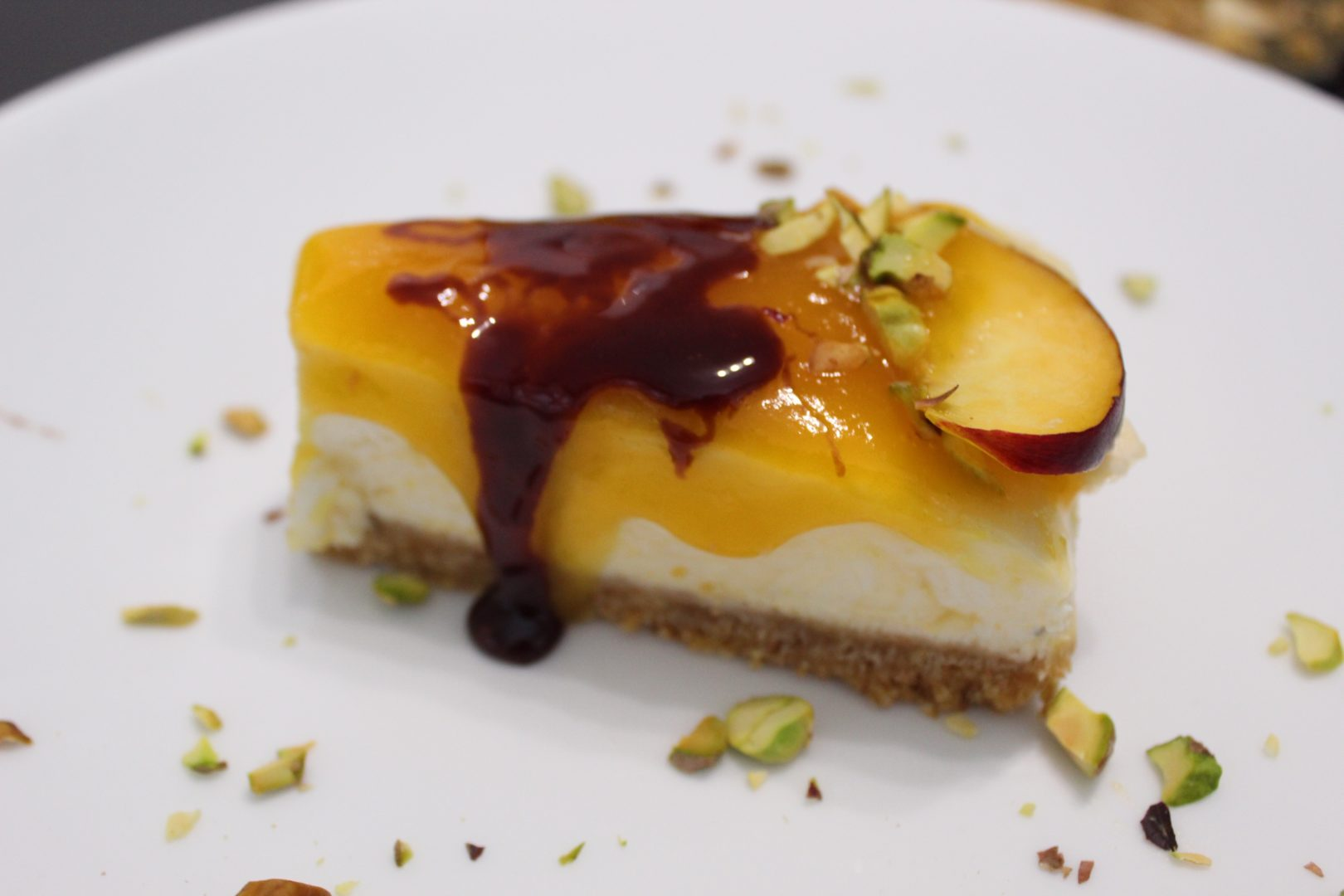Cheesecake alle pesche con riduzione di Montepulciano cocendolibando